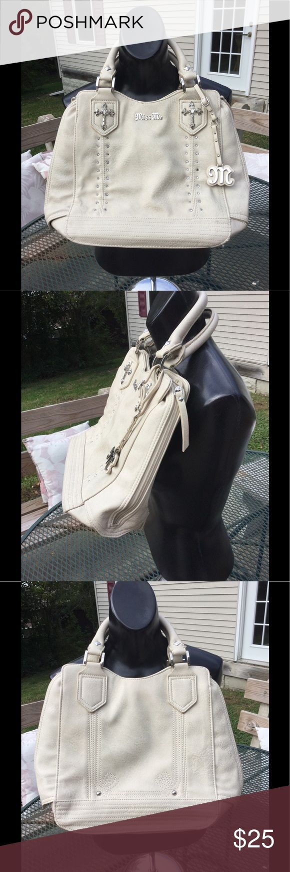 Miss Me purse Guc, 5th picture shows 1 stud missing. Cream colored Leather. Could use a leather cleaner, but it's not bad! Good sized and super cute! Inside very clean! Comes with free Miss Me very used wallet! Miss Me Bags Shoulder Bags