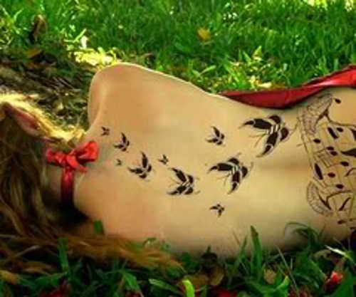 Feminine tattoo 110 sexy butterfly tattoos on upper for Feminine music tattoos