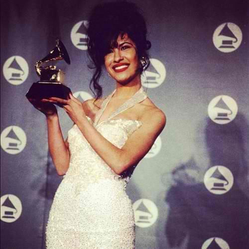 Selena Quintanilla Perez.  Not sure why bc I could never understand more than half her songs, but I loved her growing up. The movie Selena was my fav and it started from there.