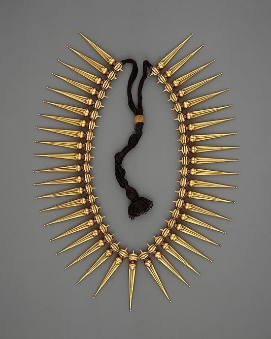 *Jasmine-Bud Necklace (Malligai Arumbu Malai).  India (Tamil Nadu and Kerala)  Medium: Gold with rubies strung on black thread.  19th century