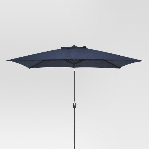 The Rectangular Patio Umbrella from Threshold is just what you need to enjoy sunny days under the shade. Relax with your family and friends under the cool shade of this sleek piece. This umbrella is sure to give your outdoor decor a modern makeover. This polyester shade is weather-resistant and is characterized by crank-type lift and push-button tilt.