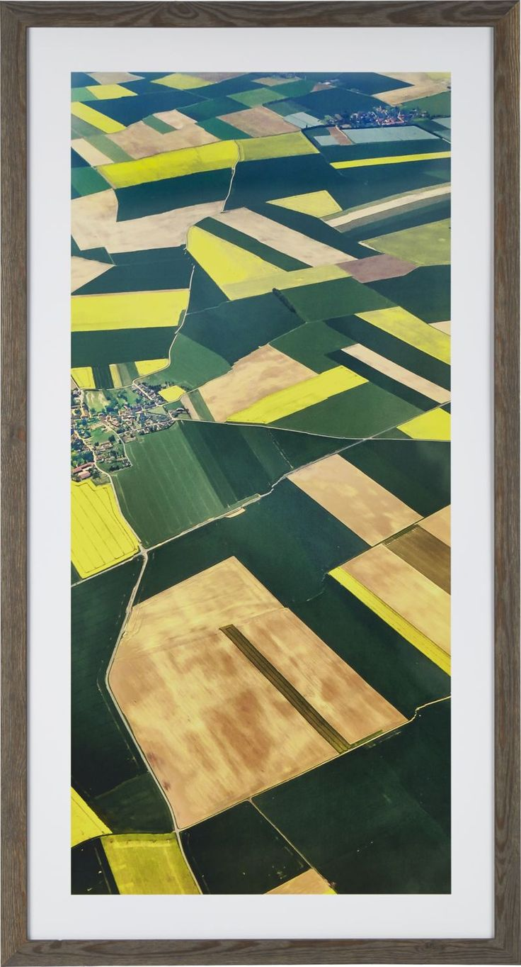 From the bird's eye view of an approaching aircraft, Colby Chester photographed the patchwork of verdant fields found outside of Paris, reinterpreting the panorama in a richly colored watercolor painting that plays both abstract and representational.  To preserve the beautiful color of our giclée reproduction, each print is UV-protected with a special coating and glass.  Parana pine frame is finished in distressed grey.