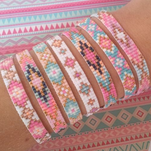 Bracelets, bracelets, bracelets. A nice play of patterns within a restricted palette of subtle colors.