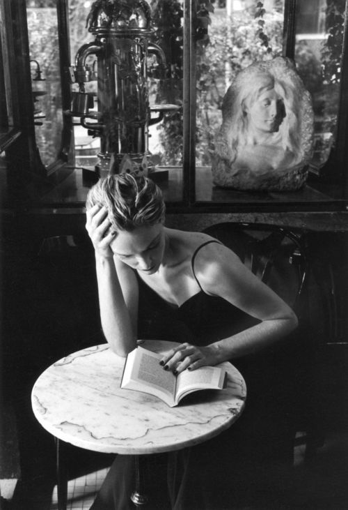 """books0977:  A reader in the Caffè della Pace in Rome. Photograph by Fernando Scianna (Italian, 1943-). ""It's his picture, like a quick, swift organization of reality, a catalyst of objective reality in photographic reality: that almost everything on which his eye rests and rises obeys his goal at that time, neither before nor later, for instant magnetism, his feelings, his will, and - ultimately - to his style."" — Leonardo Sciascia  """