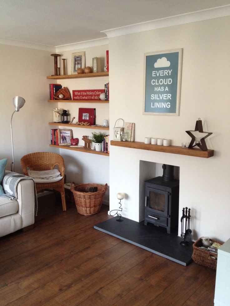 Eclectic living room, with oak floating shelves and log burner! Nice and cosy!