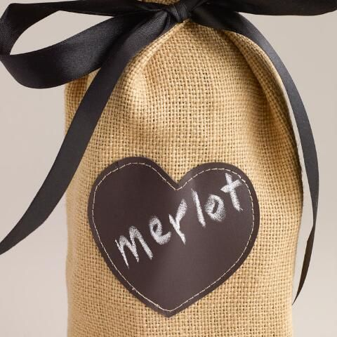 Our exclusive Jute Wine Bag with Chalkboard Label is a chic way to present a bottle of wine for Valentine's Day and other special occasions. Crafted of natural jute, this reusable bag features a leather chalkboard label for adding a personal touch with the included chalk. Write the name of the wine or a special message on this memorable and stylish gift bag.