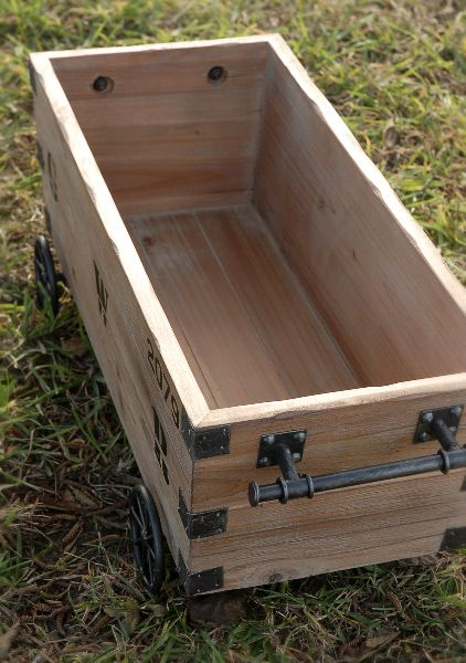 You'd probably want to sand off any splintery bits, but this would make a reeeeally cute caddy for stuffed animals/similar toys.     Vintage Pallet Storage Crate with Wheels $59