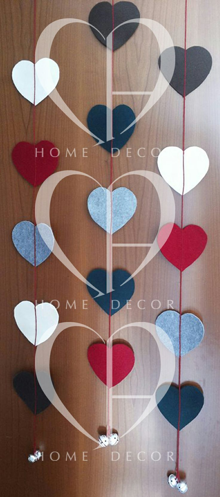 Hang Window / door hanger made with felt hearts in brushed cascaded with rattles mascot to close.