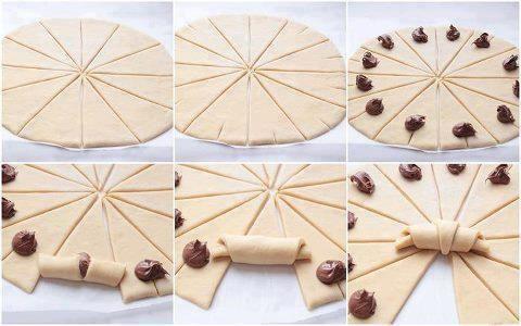 Croissants de Nutella 1 huevo, Leche de QB, Papel parafinado, Azúcar en polvo para espolvorear, 1 pacote Nutela . Preparación: Colocar huevo en un recipiente y un poco de leche y revolver hasta homogeneizar. Corte para que queden triángulos. En cada triángulo una cucharada de nutella y luego como si fuera el pegamento en los bordes del triángulo pasar la mezcla de huevo. Precalentar el horno a 170 º c y a la izquierda por 15 minutos, pero esto dependerá del gusto de cada uno...