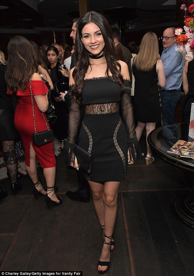 Glammed up: Justice's raven locks were coiffed by Paul Norton and she sported a cabernet pout applied by Lusine Galadjian