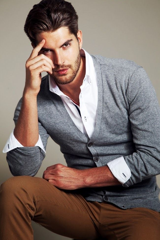 Nick Bateman's style for men: Grey cardigan, white shirt and brown trousers