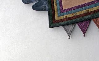 Broderade änglar - detalj av quilt