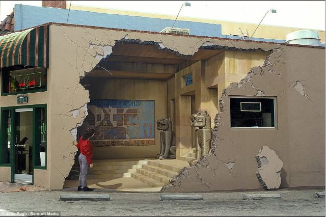Main Street, Los Gatos, California. Even the woman peering into the ruin is part of the mural.