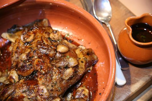 Roast shoulder of lamb  2 day marinating and long, slow cooking time guarantees an extremely moist, deliciously flavoured meat.  The balsamic vinegar adds a wonderful glaze to the meat and perfectly complements the richness of the lamb