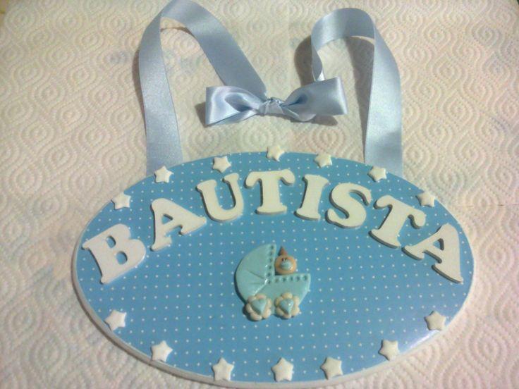 Cartel oval para bebé con cochecito y estrellas con cinta de raso.