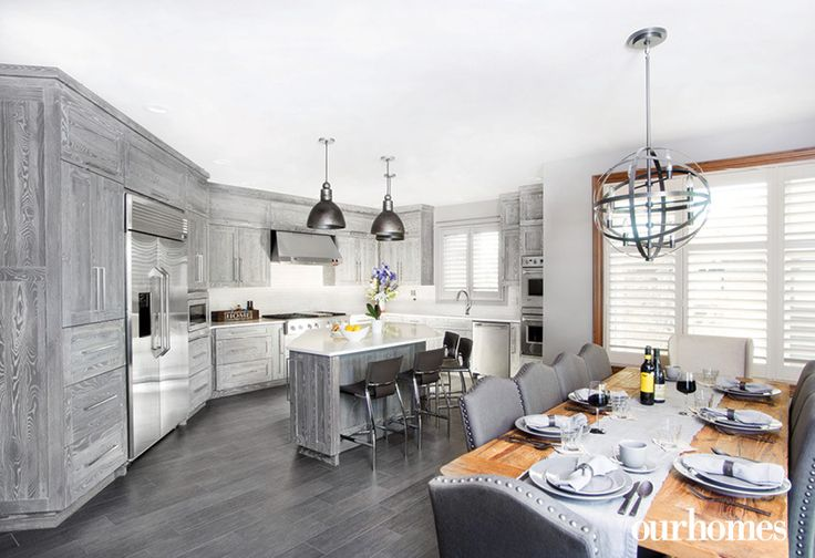 Family dinners are all about fun. The sleek grey kitchen provides easy clean-up.    http://www.ourhomes.ca/articles/build/article/a-place-where-family-comes-first