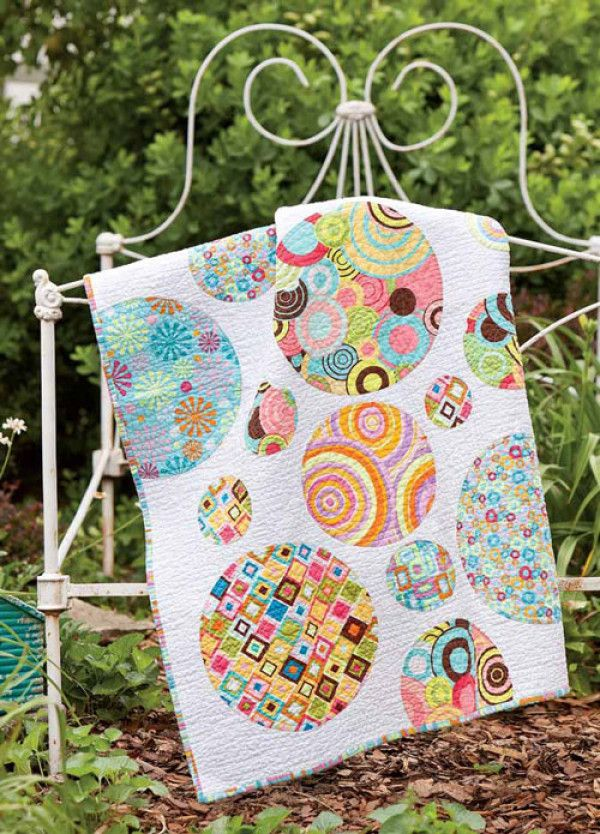 Designer Marianne Haak made this quilt for her first grandchild, Paige. Her daughter asked for graphic, yet simple crib quilt so they dove into Marianne's stash of fabric and this is what they came up with. Quilt designed by Marianne HaakQuil