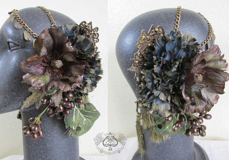 Fall themed headdress created for MYTH Masque. Dyes and paints were used to transform the faux flowers into a state of decay, and further embellished with glitter and crystals. The chains and tassels are all antique gold hardware. By Anachronism In Action