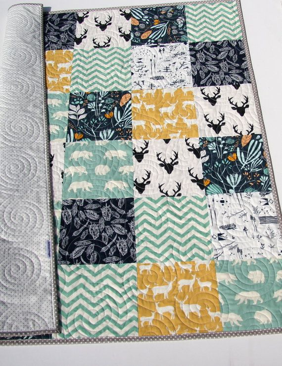 Ready to Ship! Woodland Animals, Deer Quilt, Bears Buck, Southwestern Modern Bedding, Navy Blue Yellow Teal, Chevron, Baby Boy Bedding, Toddler Bed Blanket, Rustic Forest The colors are nice and modern ivory, grey, yellow, white, mint green, and navy blue. You can choose the size baby (34x41) or toddler (34x50). This would make a perfect blanket for the little one in your life! Deer, woodland forest, bears, elk, trees, feathers and chevron all adorn this whimsy quilt.  A quilt is three…