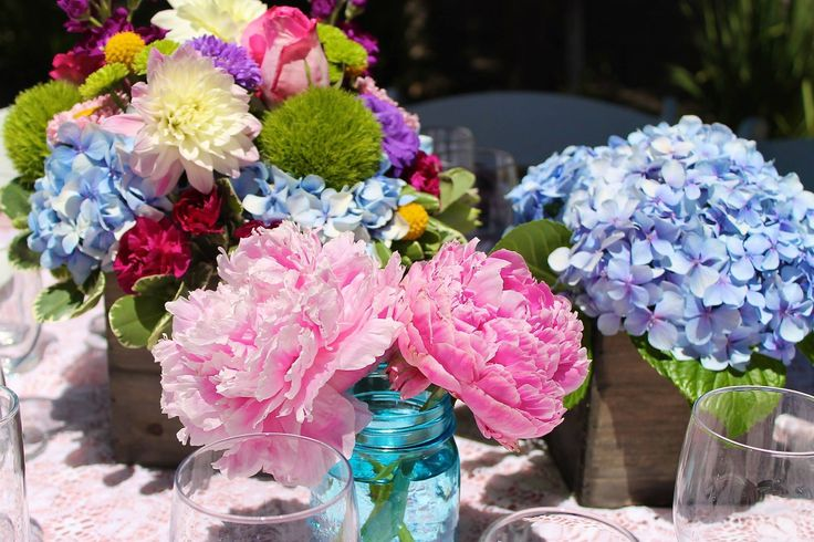 flowers hydrangeas, blue mason jars, peonies, wood vases