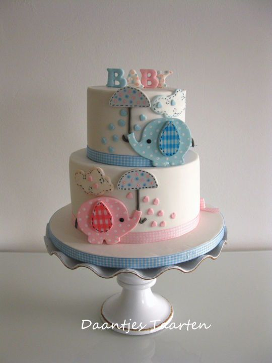 A lovely babyshower cake with elephant figures from cakesdecor