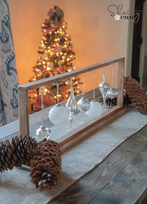 Hanging Christmas ornaments in a wood frame.