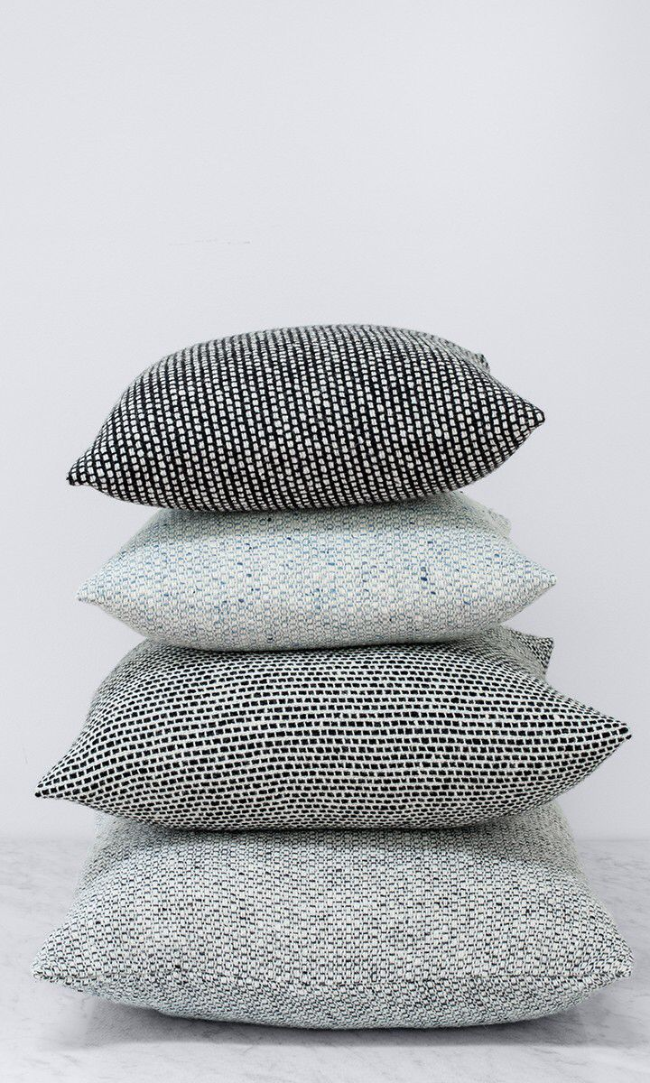 Tweed pillows! Another great texture perfect for both husband and wife.