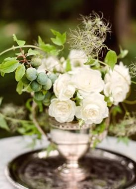 Grapes in the arrangement. Love green flowers and arrangements.