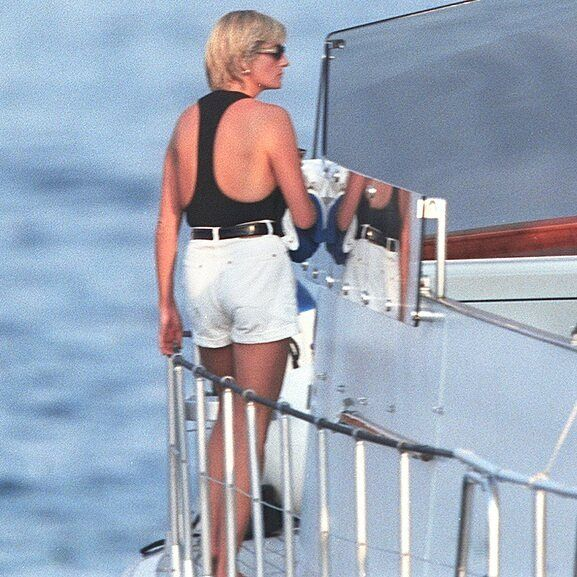 """22 August 1997: A paparazzi photo of Princess Diana onboard a speed boat at St. Tropez in South of…"""""""