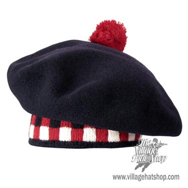 MADE IN CANADA. A tam-o-shanter is a variation of the Scottish bonnet named after a character in the poem by Robert Burns. This specific style is worn by sportsmen in the popular Scottish and Canadian sport of curling.  Made especially in Navy for the Village Hat Shop. This cap is made of heavy brushed wool with a pom-pom in the center. The cap is 100% wool exclusive of the trim. Color: Navy Blue with Checkered Trim.