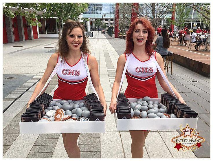Cheerleader cigarette girls passed out Super Bowl treats to all of the Houston volunteers, Avenida Houston, J&D Entertainment www.jdentertain.com