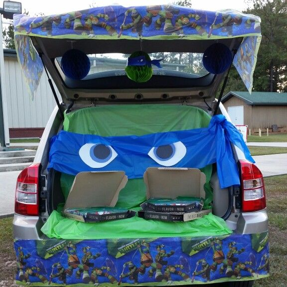 Teenage Mutant Ninja Turtle Trunk or Treat (candy in empty Pizza Hutt boxes)…