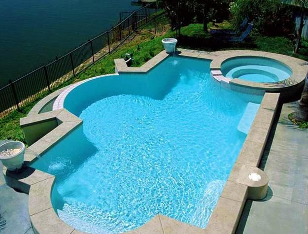 30 Outdoor Swimming Pools Spectacular Water Features Tucked Into Hillsides In 2020 Pool Designs Swimming Pool House Pool Landscaping