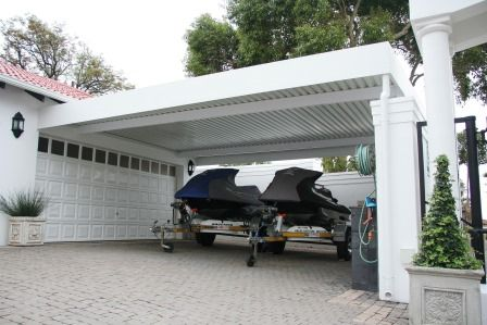 Our carports are available in a wide range of colours and materials and are purpose designed to suit the style of your house, office complex or factory.
