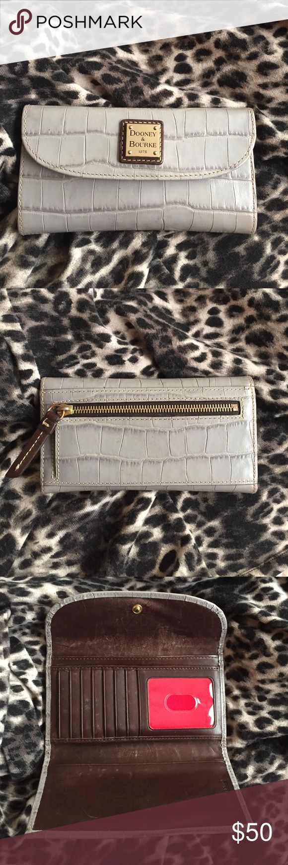 D&B Gray Croc Print Clutch Wallet Awesome Dooney & Bourke clutch wallet with tons of card, cash, and coin storage. Well loved but with plenty of time left in this timeless design! Calling this good used condition bc of very small marks shown in bottom pic, taken from about 2 in away. Dooney & Bourke Bags Wallets