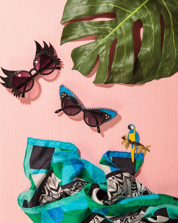 June 2012 Must-Haves - You'll blend right in with the birds of paradise in these out-there sunnies and a silky scarf.