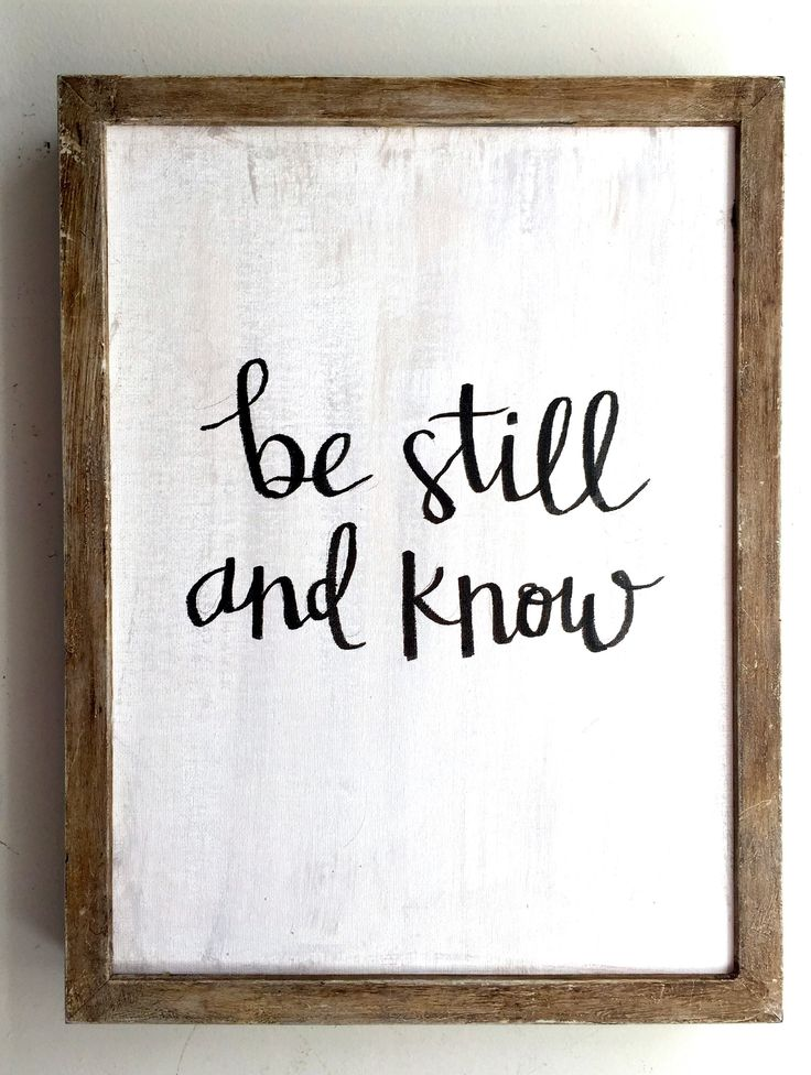 """""""Be still and know"""" is taken from Psalms 46:10 which commands us """"Be still and know that I am God"""". This framed quote for your home is hand written in calligraphy and framed in a neutral wood frame wi"""