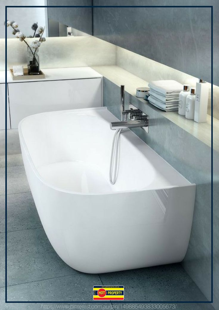 A contemporary bathroom fitted with a luxurious tub.