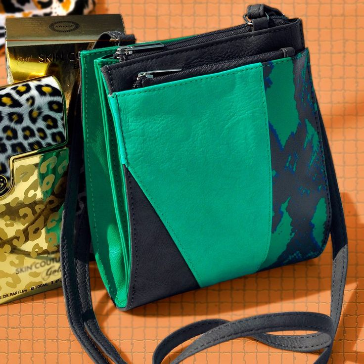 A Stylish Mini-Sling for your daily essential! Our mini sling bags are popular and trendy to carry! Made from cruelty-free material, this bold, color-blocked beauty exudes chic fashion and allows you to hold your miniature essentials comfortably on all travel trips. This unique sling design in flawless sophistication is perfect to accentuate any look. With a long strap to hang across your body, pick this mini sling in a gorgeous color and size at our Exclusive Baggit Stores or www.baggit.com