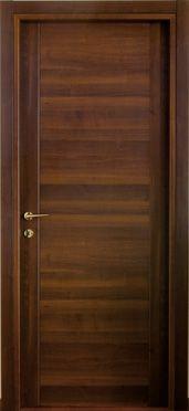 #Infissi interni #Porta modello 1C in #legno listellare. Rivestimento esterno in Laminato. #Colore: #Noce Nazionale. Linea Complano - Catalogo Motivo.