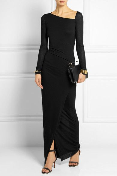 An investment piece for your wardrobe which you can wear time and time again. It's going to make your figure look amazing because it's HELMUT LANG. It has an open detail at the back too.