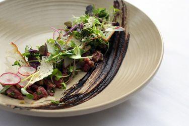 Beef tartare, black garlic, radish and caper berries