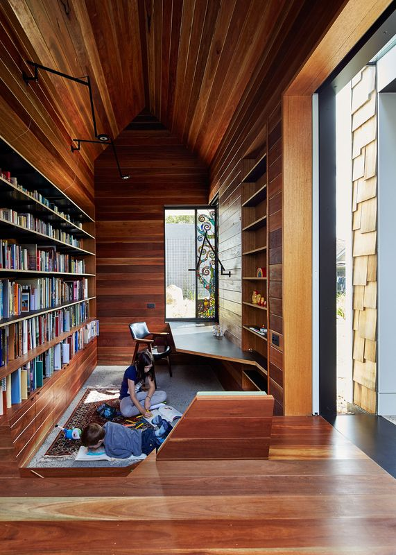 "The library is lined in reclaimed spotted gum that Maynard says ""brings with it wisdom from its previous life."" A stained glass window by Leigh Schellekens makes the contemplative room feel like a domestic chapel."