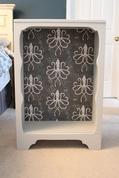 Making over a vintage bookcase with fabric from Spoonflower