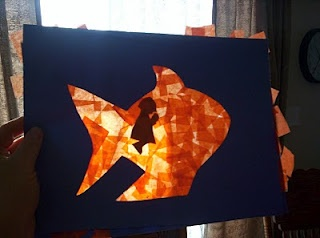 Cut Jonah out of black construction paper, then have kids cover sheets of contact paper w/small squares of tissue paper.  When the sheets are completely covered, put Jonah on top & cover the whole thing w/another sheet of contact paper, sticky side in. Then, glue the contact paper with Jonah in the back behind blue construction paper w/fish shape (I'd cut out a whale...) cut out. When you hang it, with Jonah on the backside, he only shows up inside the fish when the sunlight streams thru.
