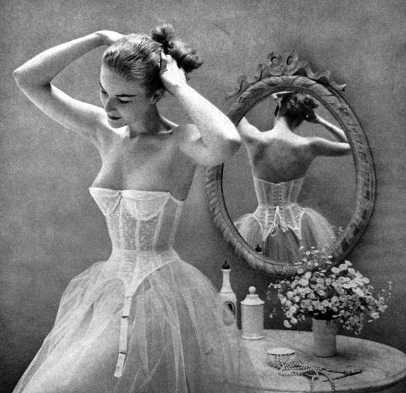 Fifties' corset and petticoats, as seen in Vogue US, 1951