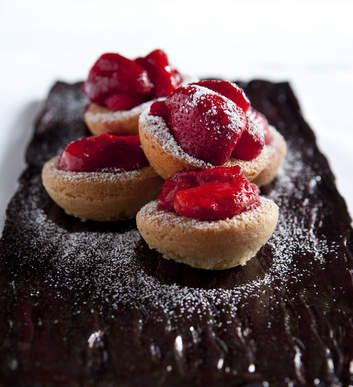 Justin North's strawberry and coconut friands. This is a wonderful, easy recipe. Adding the strawberries halfway through cooking is genius as the juicy, semi-cooked berries are just heavenly.