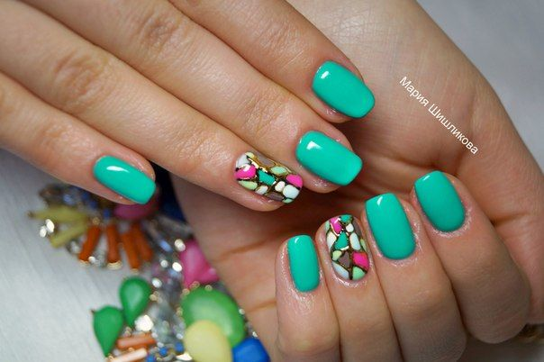 Bright manicure looks excellent in spring and summer. Original, colorful, but non-toxic base color attracts attention and emphasises an abstract drawing on the ring fingers. Such a nails can properly complement the bright summer dress, or become a real decoration of your image in the low-key casual clothes.