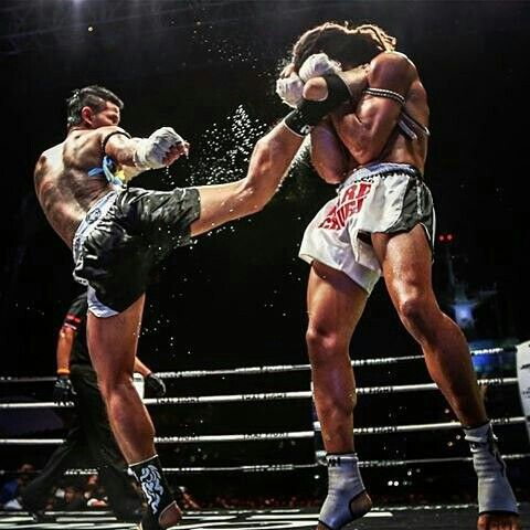 Delivering the lethal spinning kick with such a force in a kickboxing match.