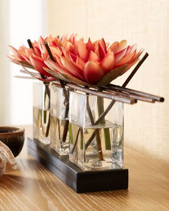 flower arrangement for large blossoms: three small vases with long twigs across the top :)